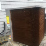 A condenser unit with coating applied by Robert Post HVAC to protect from the unit from the salt air in Mantoloking Shores, Brick, NJ